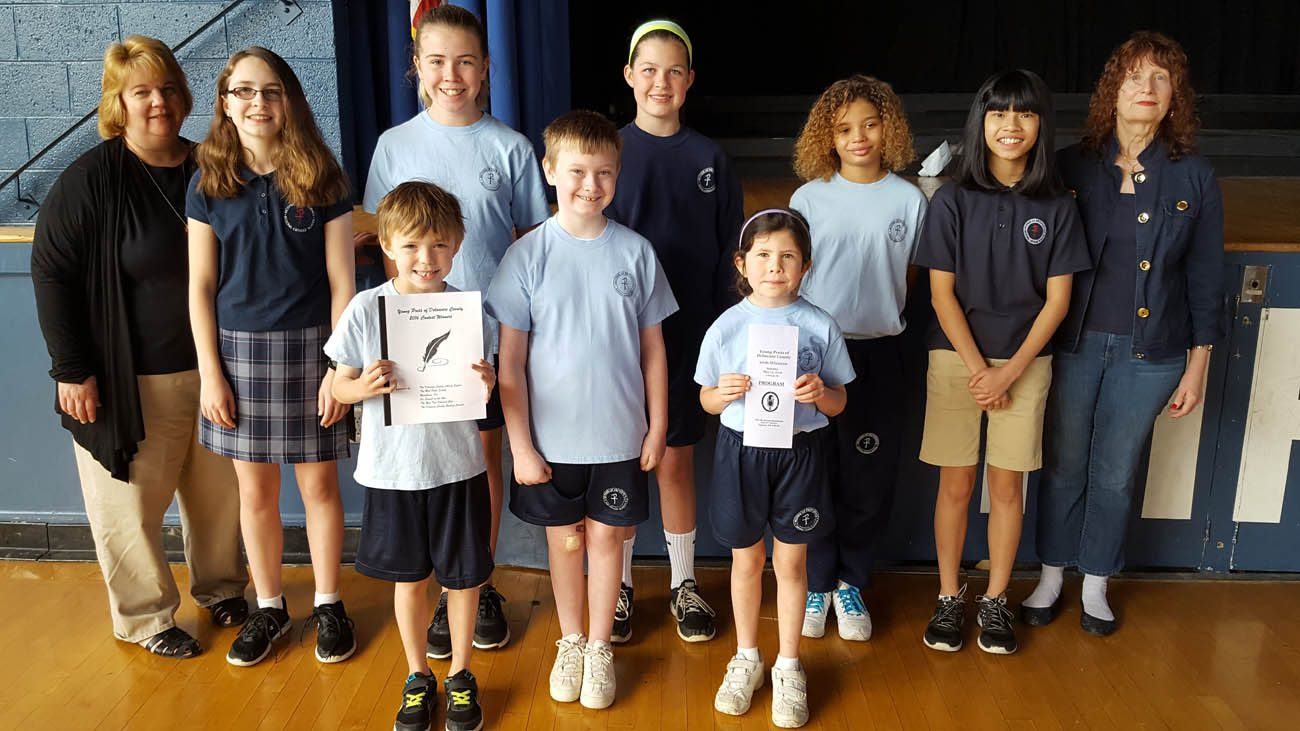 The students of Mother of Providence School in Wallingford, and their teachers, show their poems which they read a recent competition in Delaware County.