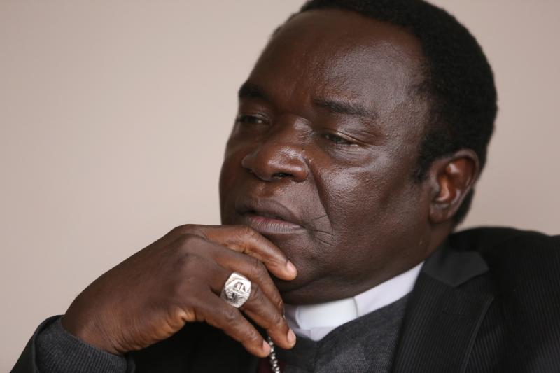 Nigerian Bishop Matthew Hassan Kukah of Sokoto pauses during an April 29 interview in Washington. (CNS photo/Bob Roller)