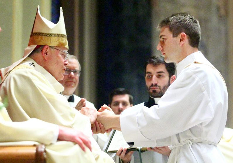 Matthew Biedrzycki makes his priestly promises before Archbishop Chaput during the ordination rite.