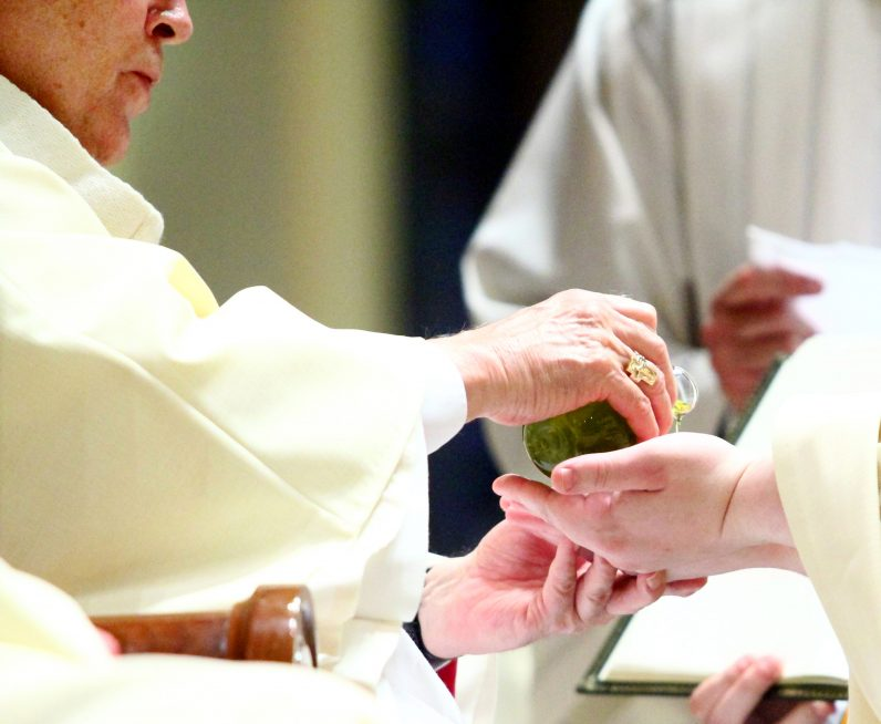 Archbishop Chaput anoints the hands of Father Matthew Windle during the ordination rite. The cloth used to clean Father Windle's hands of the sacred chrism was given to his mother, Marie Windle.