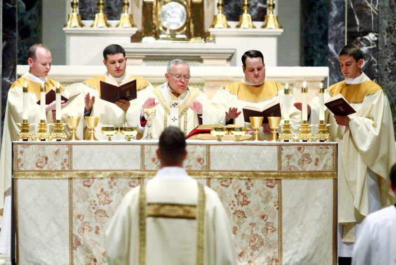 The new priests concelebrate the Liturgy of the Eucharist with Archbishop Chaput.