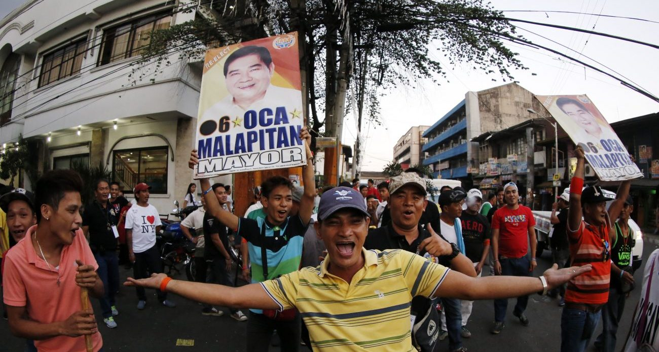 Filipinos gather in the street after national elections in Caloocan City, Philippines. (CNS photo/Francis R. Malasig, EPA)