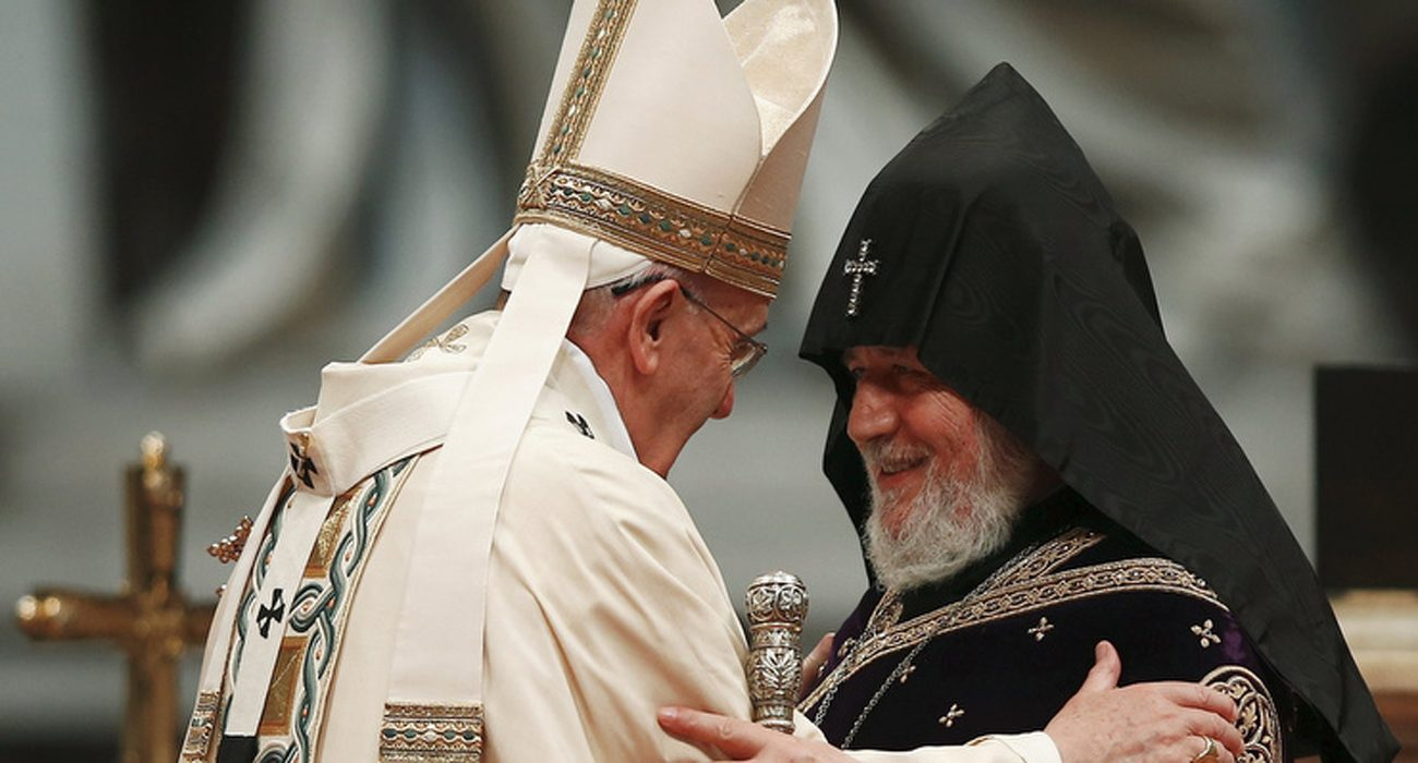 Pope Francis embraces Catholicos Karekin II, patriarch of the Armenian Apostolic Church, during a 2015 Mass in St. Peter's Basilica at the Vatican to mark the 100th anniversary of the Armenian genocide. Ecumenical relations, the memory of past suffering and prayers for a future of peace form the framework for Pope Francis' itinerary when he visits Armenia June 24-26. (CNS photo/Tony Gentile, Reuters)