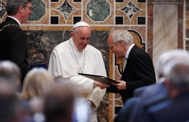 Pope Francis receives the Charlemagne Prize from Jurgen Linden, president of the Society for the Conferral of the Charlemagne Prize, during a ceremony in the Sala Regia at the Vatican May 6. At left is Marcel Philipp, mayor of Aachen, Germany, where the prize is normally presented. (CNS photo/Paul Haring)