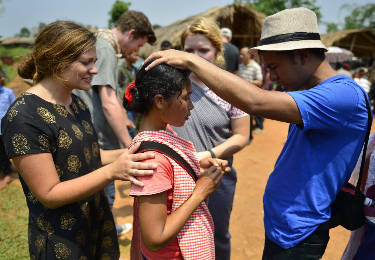 Christian missionaries pray April 30 with a Khasi tribal woman in Guwahati, India. Young women and men who are tired of today's self-centered, materialistic society should consider becoming missionaries -- the heroes of evangelization, Pope Francis said at his morning Mass. (CNS photo/EPA)