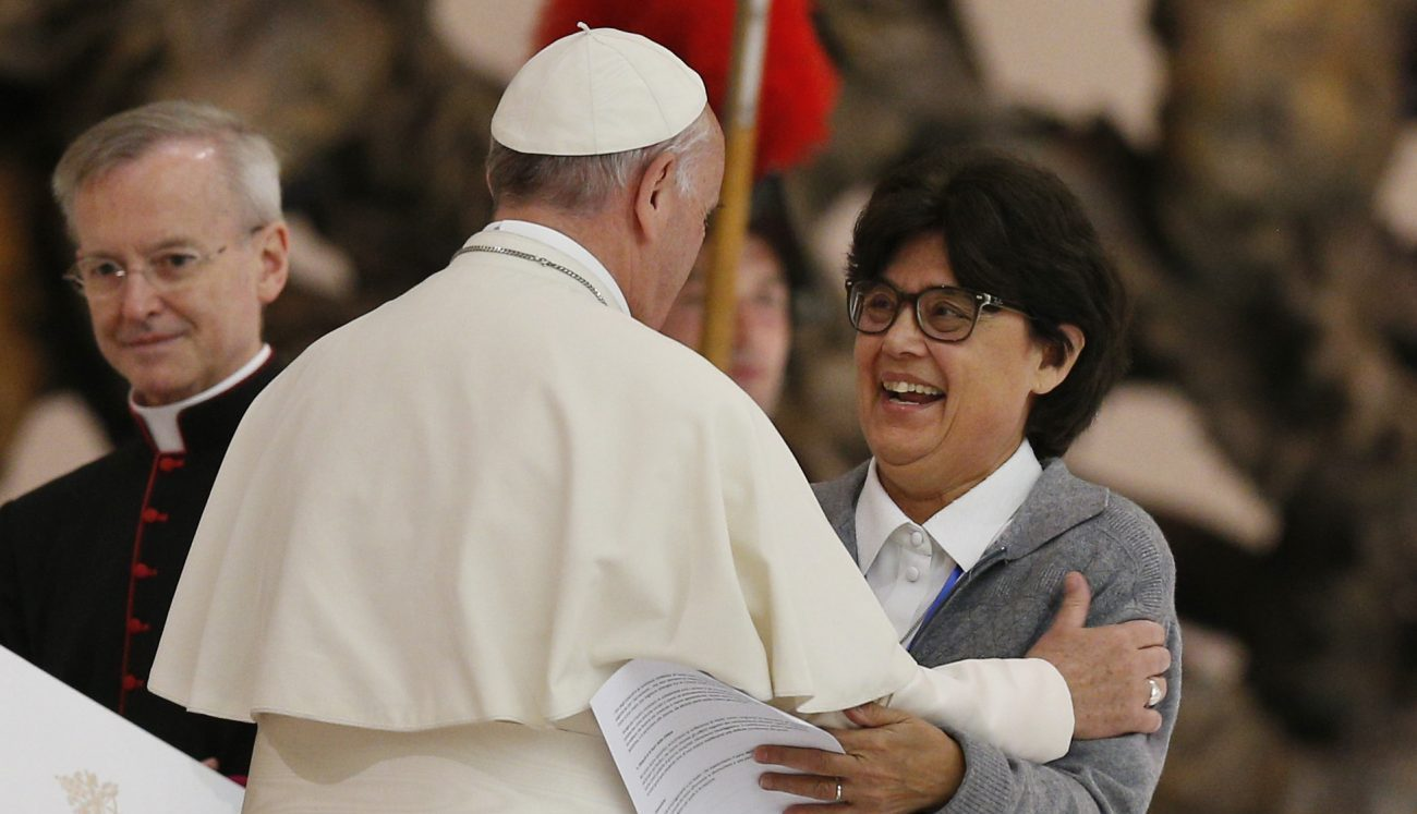 Pope Francis embraces Sister Carmen Sammut, a Missionary Sister of Our Lady of Africa and president of the International Union of Superiors General, during an audience with the heads of women's religious orders in Paul VI hall at the Vatican May 12. During a question-and-answer session with members of the IUSG, the pope said he was willing to establish a commission to study whether women could serve as deacons. (CNS photo/Paul Haring)