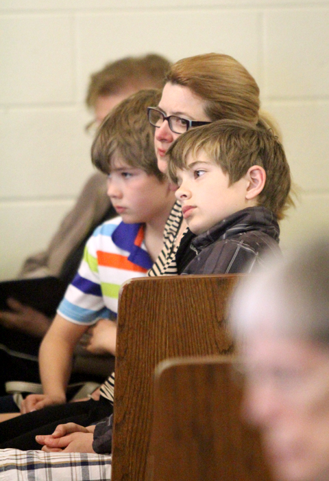 Christine Walsberg attends mass with her sons Alex and Sven.