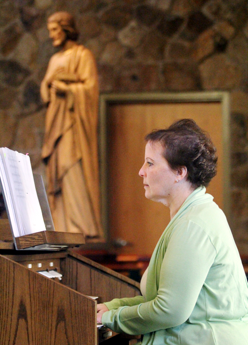 Organist Carol Phillips lends her talents to the 5:30 mass on Saturday evening at St. Thomas More Church in South Coventry.