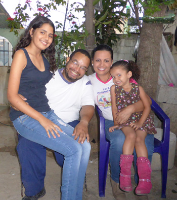 Jonny Lopez and his wife, Aura Gallardo, pose April 7 with their children Aurimar, 13, and Marijose, 3, in Barquisimeto, Venezuela. Standing in line has become a routine as Lopez tries to buy food for his family and to supply a fast-food stand that he runs on a street corner in their neighborhood. (CNS photo/Hildegard Willer)