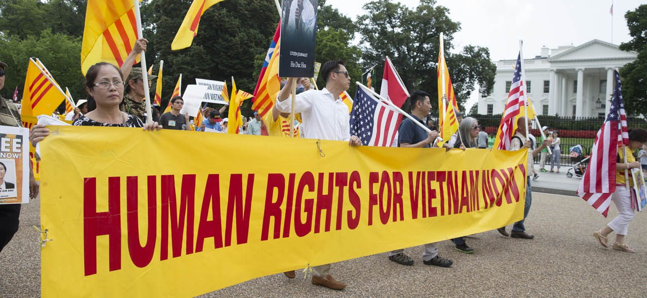 "People protest for human rights and democracy in Vietnam outside the White House in 2015 in Washington. During a May 24 news conference, U.S. Rep. Chris Smith, R-N.J., said that President Barack Obama's decision to lift the arms embargo in Vietnam ""failed to advance long-term U.S. interests."" (CNS photo/Michael Reynolds, EPA)"
