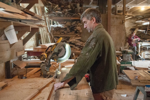 Woodworker Michael Schmiedicke works in his Strong Oaks Woodshop April 29 in Front Royal, Va. (CNS photo/Katie Scott, Catholic Herald)