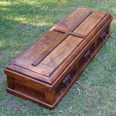 Michael Schmiedicke and his two brothers created this chestnut casket for their grandmother, a project that eventually turned into a ministry creating caskets out of refurbished lumber. (CNS photo/Katie Scott, Catholic Herald)