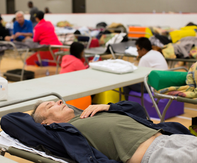 Evacuated residents rest at a community center May 4 in Anzac, Alberta, after being ordered to be evacuated due to a raging wildfire. The wildfire has forced the evacuation of the entire city of Fort McMurray. (CNS photo/Topher Seguin, Reuters)
