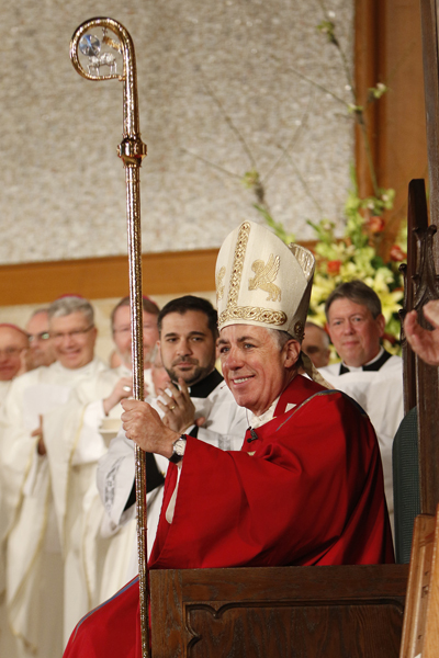 Bishop James F. Checchio smiles after receiving his crosier, miter and ring during his episcopal ordination and installation as bishop of Metuchen, N.J., May 3. (CNS photo/Gregory A. Shemitz)