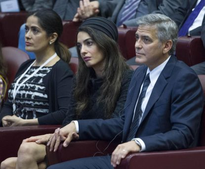 U.S. actor George Clooney and his wife, Amal, along with actress Salma Hayek (left), attend a meeting of Scholas Occurrentes at the Vatican May 29. (CNS photo/Giorgio Onorati, EPA)