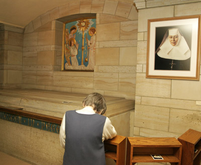 A Sister of the Blessed Sacrament prays before the tomb of the congregation's foundress, St. Katharine Drexel, whose remains will be transferred to the Cathedral Basilica of SS. Peter and Paul in Philadelphia. (Sarah Webb)