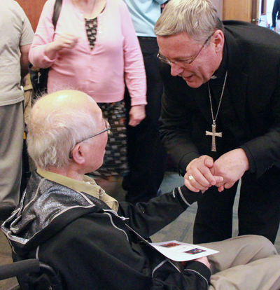 Bishop Paul Terrio of St. Paul, Alberta, talks with Deacon Raymond Chan, who serves at St. John the Baptist Parish in Fort McMurray, Alberta, after Mass May 8 at the Church of the Resurrection in Edmonton. (CNS photo/Lorraine Turchansky, Archdiocese of Edmonton)