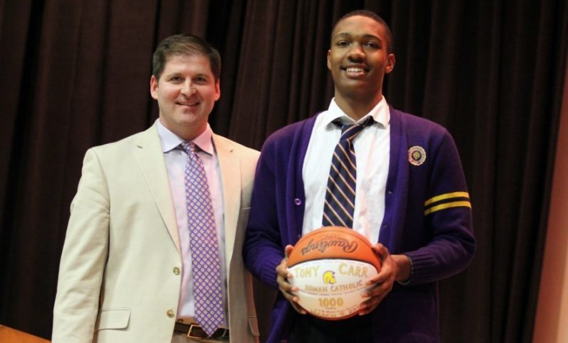 Roman Catholic basketball coach Chris McNesby, at left with senior guard Tony Carr, has resigned as the Cahillites' coach after seven seasons.