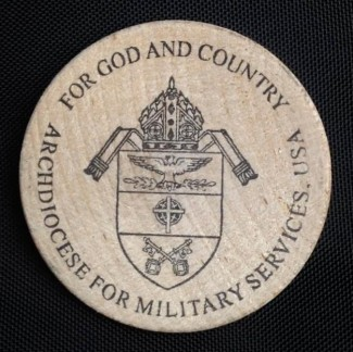 This is the coin of the U.S. Archdiocese for the Military Services. Auxiliary Bishop F. Richard Spencer of the archdiocese presented this coin, stamped with a prayer to St. Francis, to Pope Francis during his April 30 audience with military members at the Vatican. (CNS photo/courtesy of Auxiliary Bishop F. Richard Spencer)