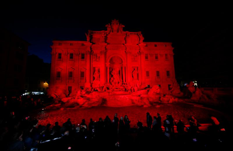 The Trevi Fountain in Rome is lit in red during an event to raise awareness of the plight of Christian martyrs April 29. (CNS photo/Paul Haring)