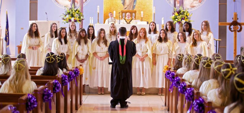 The Mount St. Joseph Academy choir sings during commencement exercises. (Bradley Digital)