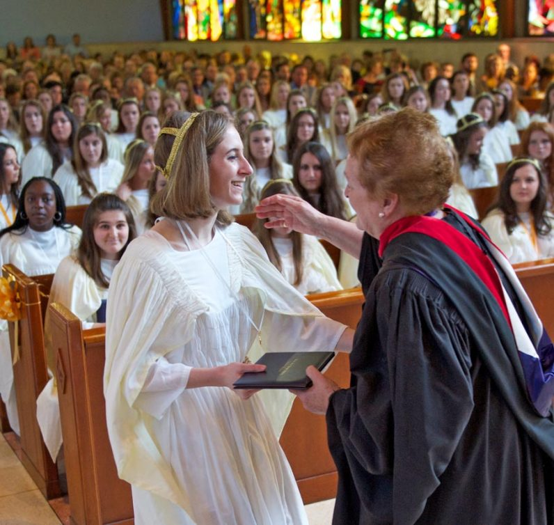 Mount St. Joseph Academy Principal Judith Caviston (right) hands out diplomas to graduating seniors at graduation ceremonies following the baccalaureate Mass at Immaculate Heart of Mary Church, with Father Michael Olivere the celebrant. (Bradley Digital)