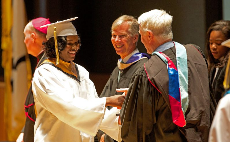 Seniors of Neumann-Goretti receive their diplomas. (Bradley Digital)