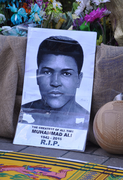 A photograph of Muhammad Ali is seen at a makeshift memorial outside the Muhammad Ali Center in Louisville, Ky., June 7. (CNS photo/Jessica Able, The Record)