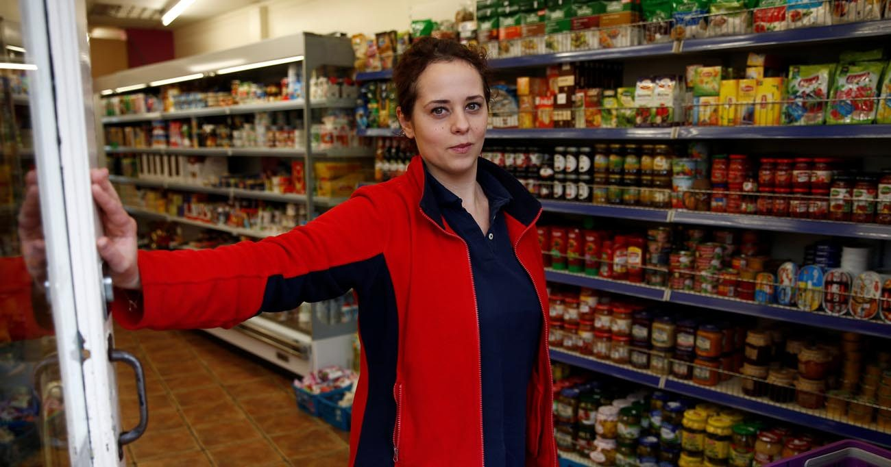 "Monika Cyrek, a Polish national who works in a grocery store that sells mostly Polish products, poses for a photograph June 18 in Walton-on-Thames, England. ""If we're not wanted here, probably a lot of people will leave and try other places,"" said Cyrek. (CNS photo/Peter Nicholls, Reuters)"