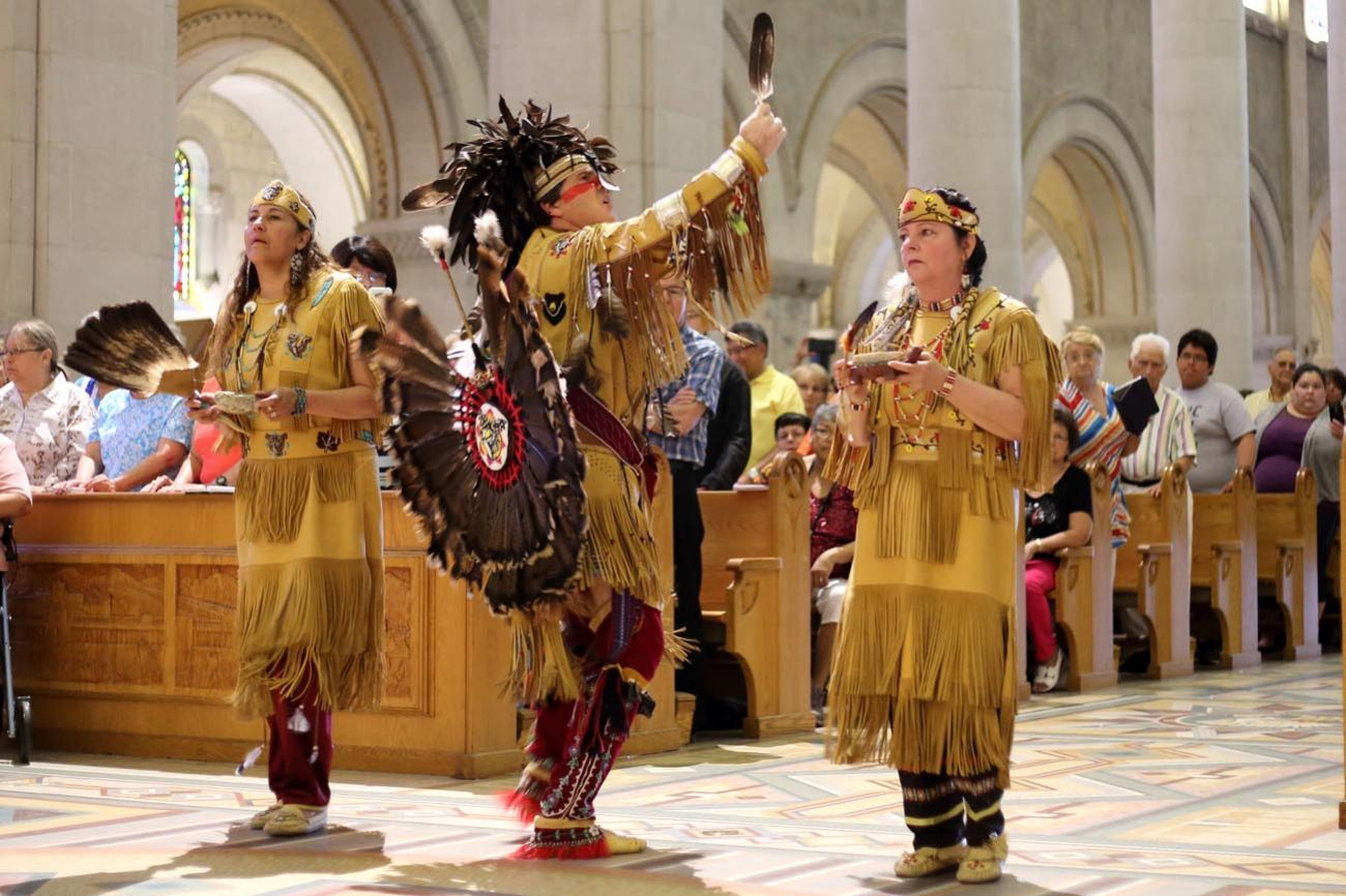 Members of the Huron-Wendat Nation perform a purification ritual at the Basilica of Sainte Anne-de-Beaupre in Quebec June 26. (CNS photo/Philippe Vaillancourt, Presence)