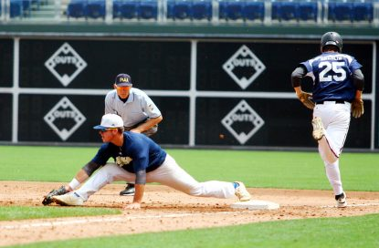 The Catholic League turns a double play in the sixth inning.