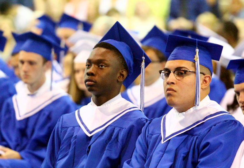 Graduates of Conwell-Egan Catholic High School in Fairless Hills listen to a commencement speaker. (Sarah Webb)