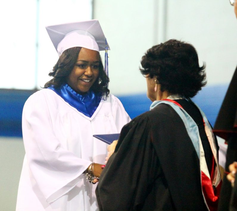 Meghan Didier proudly accepts her diploma at Conwell-Egan's commencement exercise on Tuesday, June 7. (Sarah Webb)