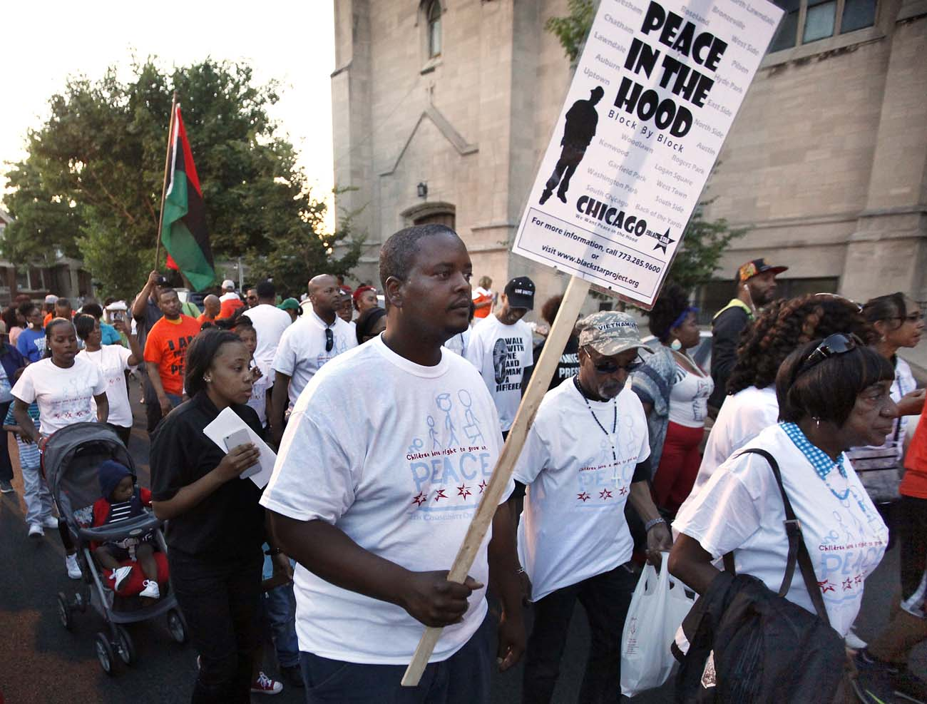 Participants walk during a march to kick-off the beginning of summer and call for an end to violence in their community June 17 in Chicago. The march followed a rally held in front of St. Sabina Church. (CNS photo/Karen Callaway, Catholic New World)