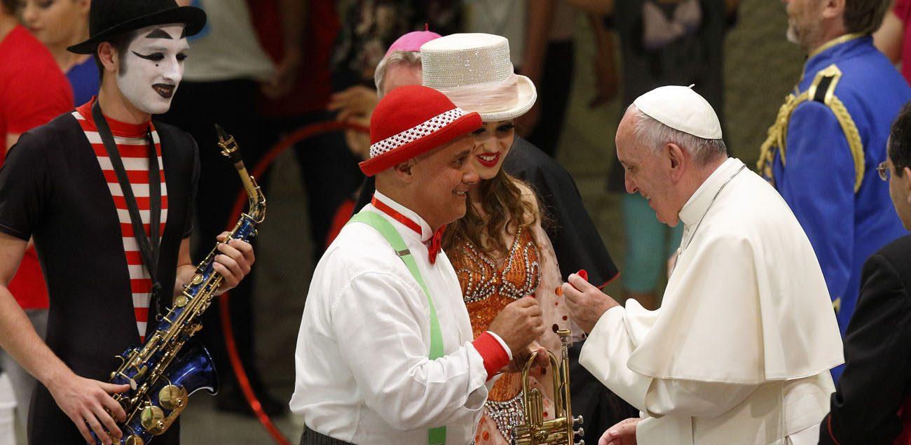 Pope Francis greets artists during an audience with circus members in Paul VI hall at the Vatican June 16. (CNS photo/Paul Haring)