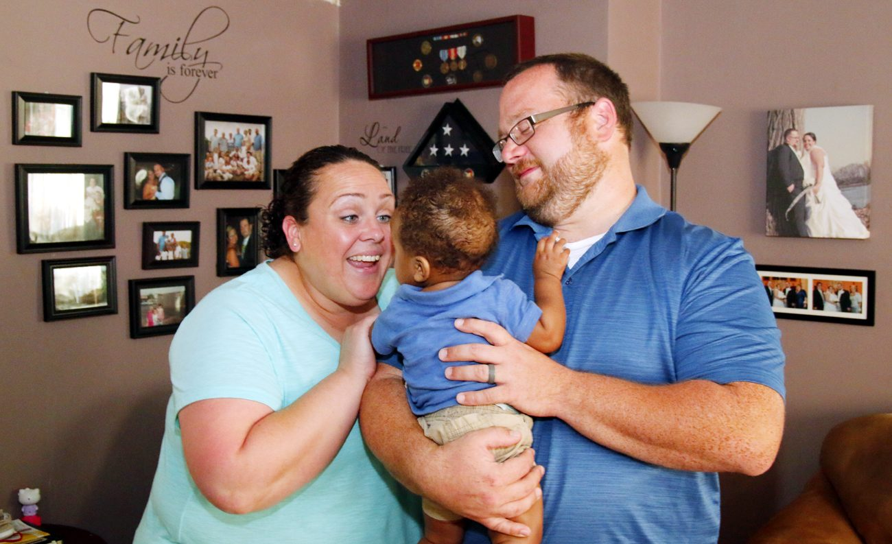 "Nicole and Michael Darrah with their foster son, ""Jay."" (Sarah Webb)"