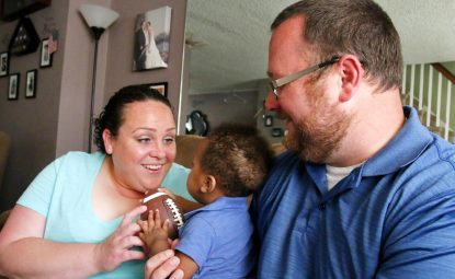 """Nicole and Michael Darrah enjoy playtime with their foster son, """"Jay."""" (Sarah Webb)"""