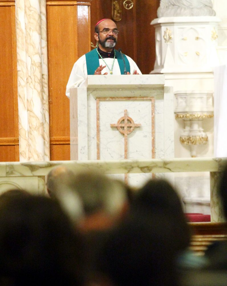 Guest homilist Bishop Varghese Thottankara, C.M., a bishop in Ethiopia, speaks to the congregation about the need of his mission diocese.