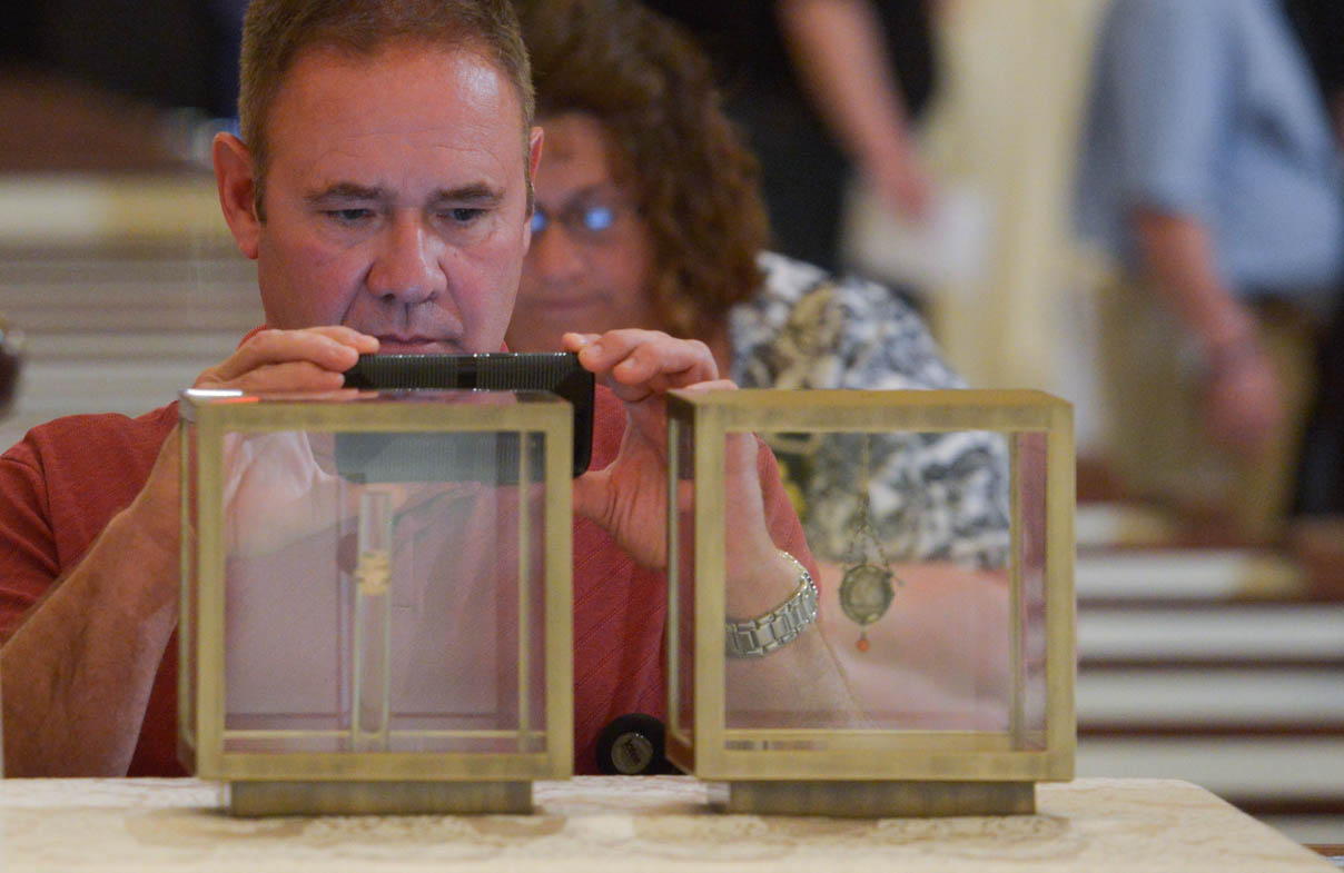 Jim Landers takes a photo of relics of Sts. Thomas More and John Fisher at the Fortnight for Freedom opening Mass June 21 at the Basilica of the National Shrine of the Assumption of the Blessed Virgin Mary in Baltimore. Landers' great-great-grandfather, Daniel Lawson Moore, was a relative of St. Thomas More. (CNS photo/Kevin J. Parks, Catholic Review)