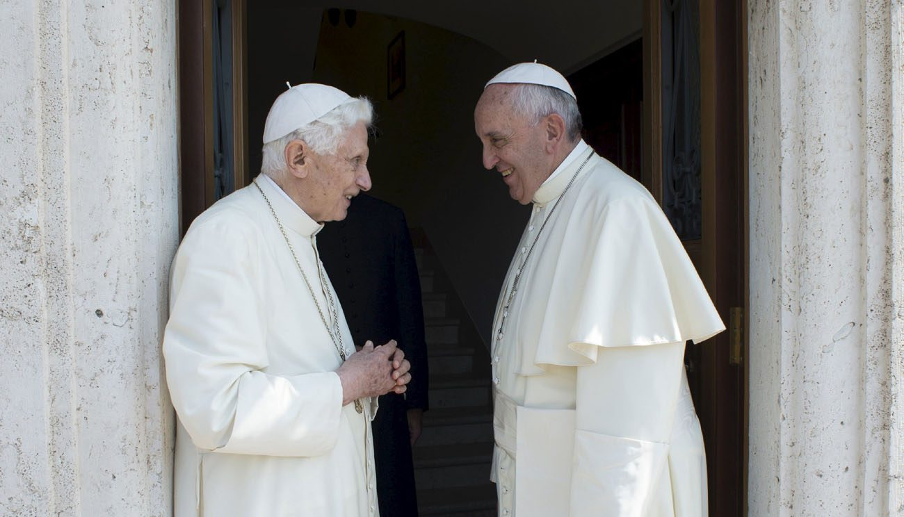 "Retired Pope Benedict XVI talks with Pope Francis during a meeting at the Vatican in this June 30, 2015, file photo. Pope Francis has written a preface to a new book, a collection of the retired pope's homilies on the priesthood. ""To Teach and Learn God's Love"" was to be released in German, Spanish and Italian June 29. (CNS photo/L'Osservatore Romano via Reuters )"