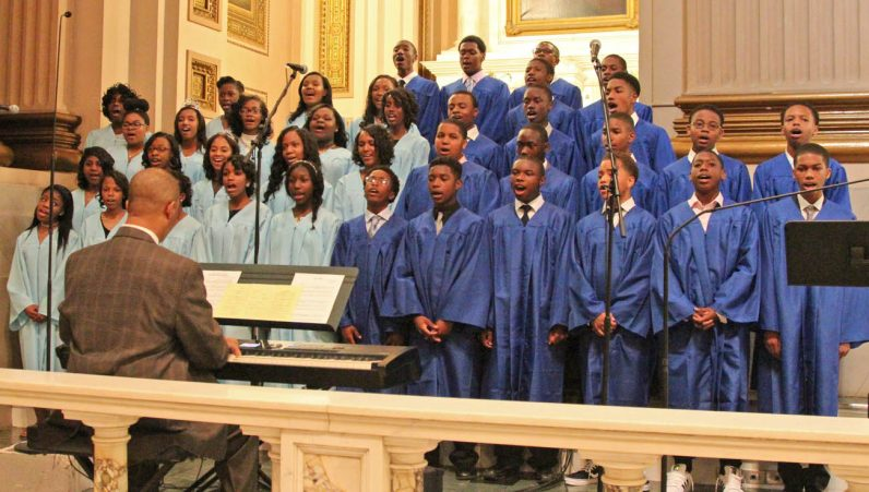 "Eighth grade graduates of the Gesu School in Philadelphia sings the responsorial psalm, ""Dear Jesus, I Love You,"" during their school's graduation ceremony."