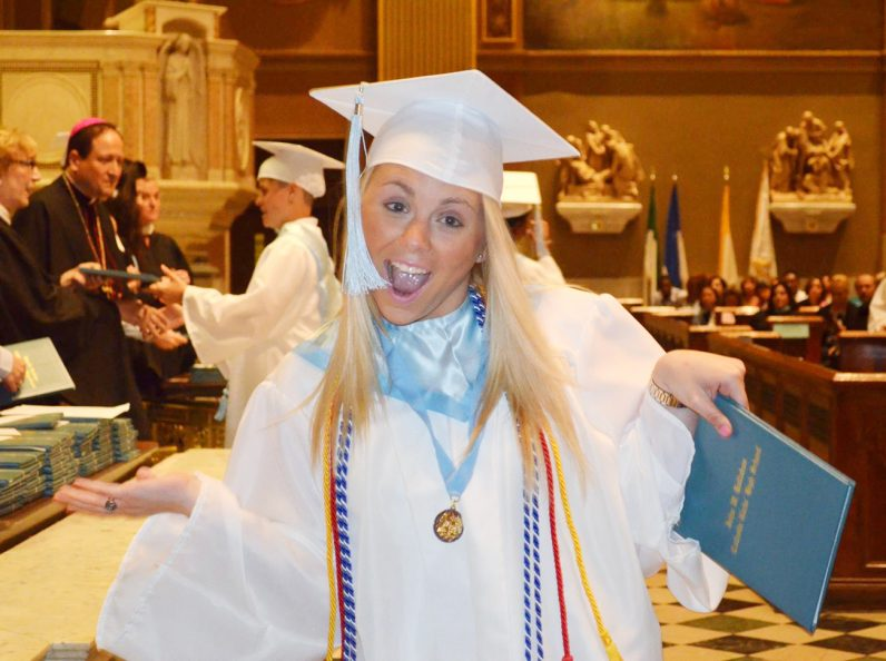 A graduate of John W. Hallahan Catholic Girls' High School can't hold back her excitement after receiving her diploma. (Courtesy photo)