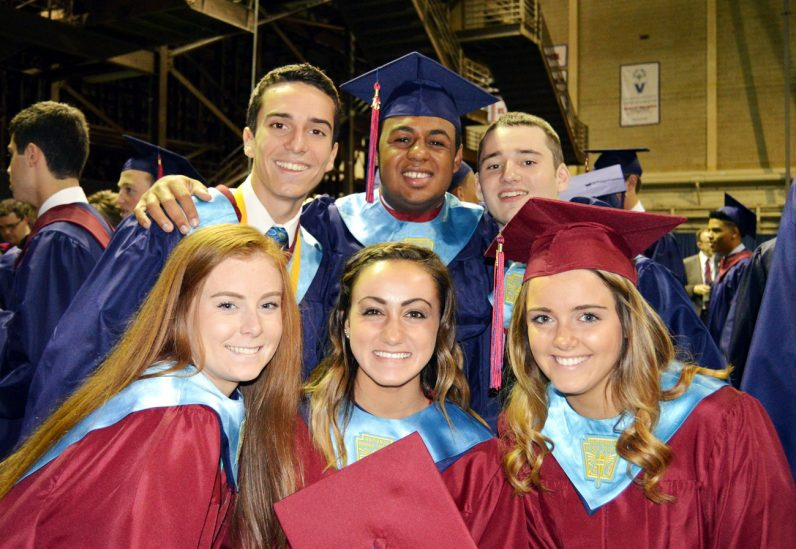 Students from Cardinal O'Hara High School are all smiles as they graduate at Villanova University on Wednesday, June 8.
