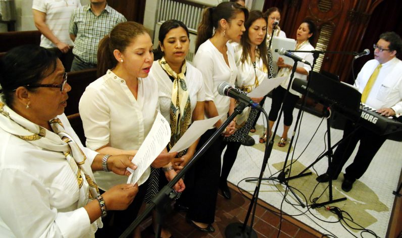 The Hispanic Choir from St. Martin of Tours Parish lend their voices for the recessional hymn.