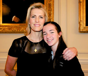 Syndicated radio host Laura Ingraham (left) poses with Regina Coeli  Academy eighth grader Anna Castagno, first place winner for Regina Academies Declamation Contest.