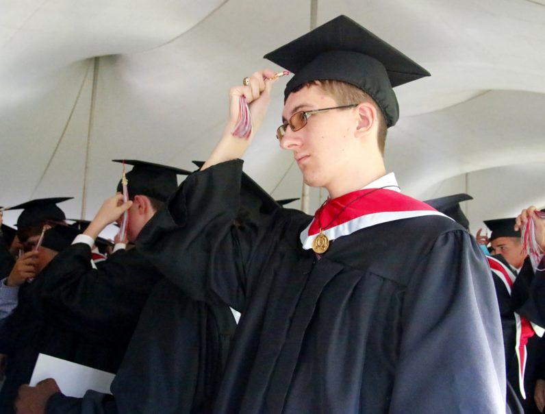 Students from Father Judge High School switch their tassels from right to left to mark themselves as graduates. (Sarah Webb)