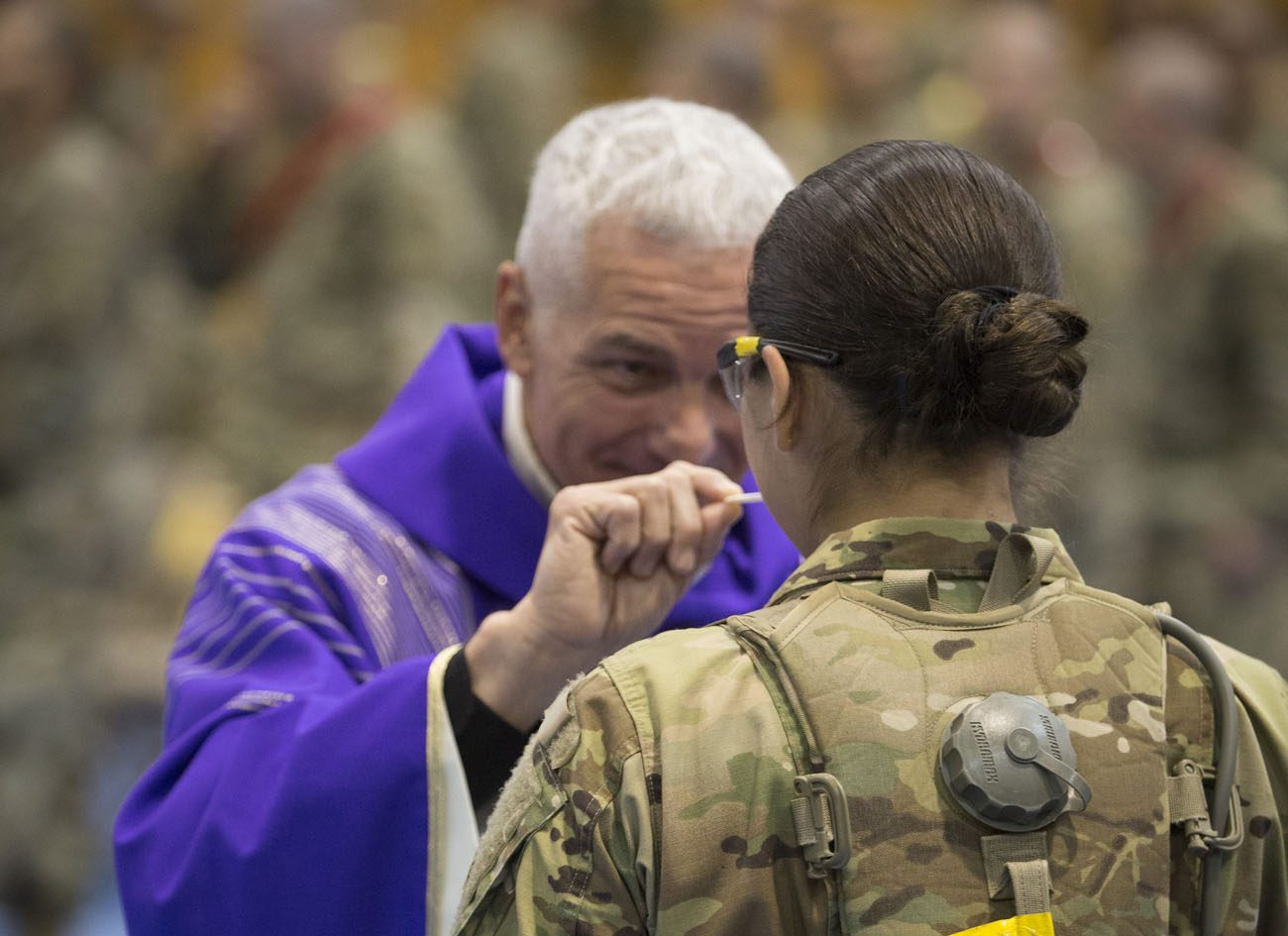 Father John G. Breaux Jr., a priest from the Diocese of Lafayette, La., gives Communion to a new Army soldier during a Mass in March at Fort Jackson in Columbia, S.C. Father Breaux was training for his new role as a military chaplain at the U.S. Army's Chaplain Basic Officer Leader Course at Fort Jackson. (CNS photo/Chaz Muth)
