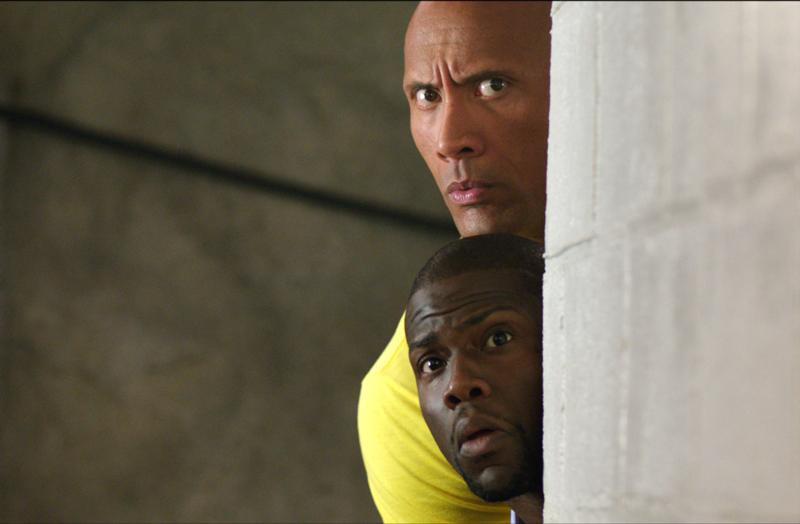 "Dwayne Johnson and Kevin Hart star in a scene from the movie ""Central Intelligence."" (CNS photo/Warner Brothers)"