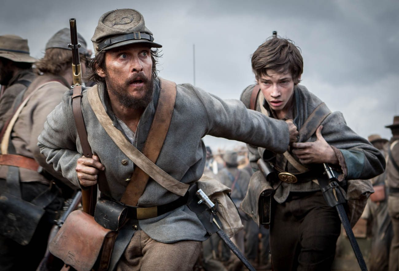 "Matthew McConaughey and Jacob Lofland star in a scene from the movie ""Free State of Jones."" (CNS photo/STX Entertainment)"
