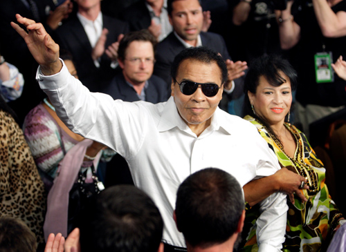 Boxing legend Muhammad Ali stands with his wife, Yolanda, as he is introduced before the 2010 welterweight fight between Floyd Mayweather Jr. and Shane Mosley at the MGM Grand Garden Arena in Las Vegas. (CNS photo/Steve Marcus, Reuters)